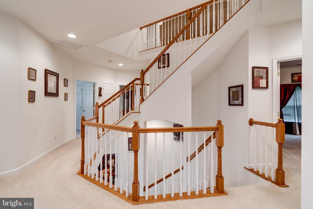 Striking three level winding staircase! - 15672 ALTOMARE TRACE WAY, WOODBRIDGE