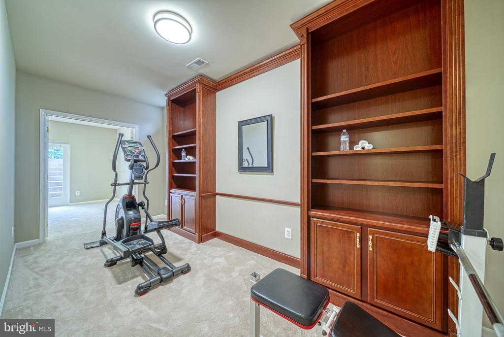 Separate Exercise Room with Built In Shelving - 1321 GATESMEADOW WAY, RESTON