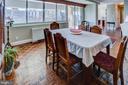 Dining room w/wall of windows - 3900 NW WATSON PL NW #A-7C, WASHINGTON