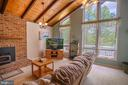 Family room with wood burning fireplace - 339 LAKE SERENE DR, WINCHESTER