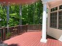 Beautiful Trex deck surrounded by trees - 7804 WINDY POINT CT, SPRINGFIELD