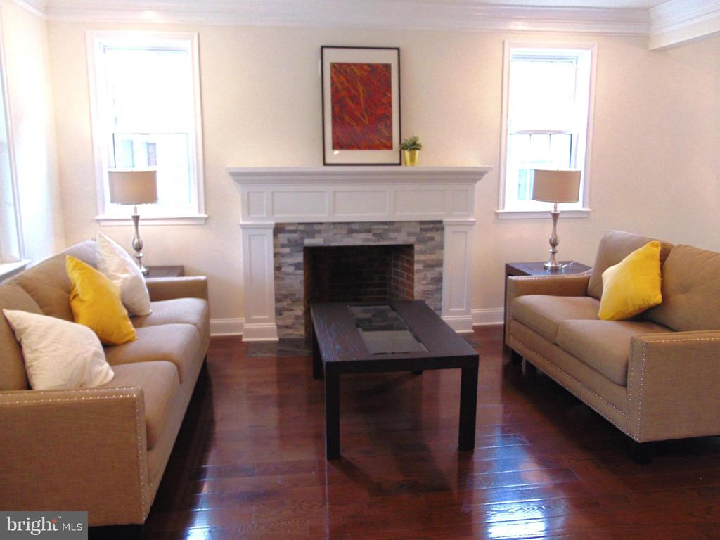 Living area with wood burning fireplace - 5710 4TH ST NW, WASHINGTON