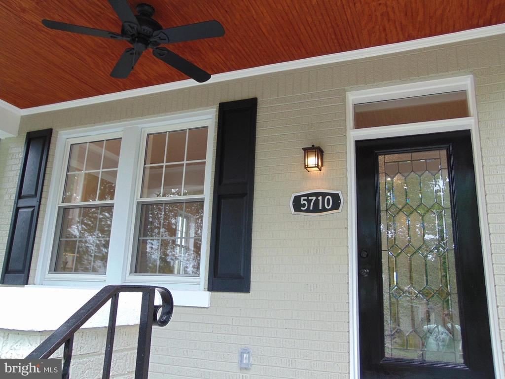 Covered porch with natural wood ceiling and fan - 5710 4TH ST NW, WASHINGTON