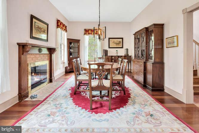 Dining room with fireplace - 23158 CANNON RIDGE LN, MIDDLEBURG