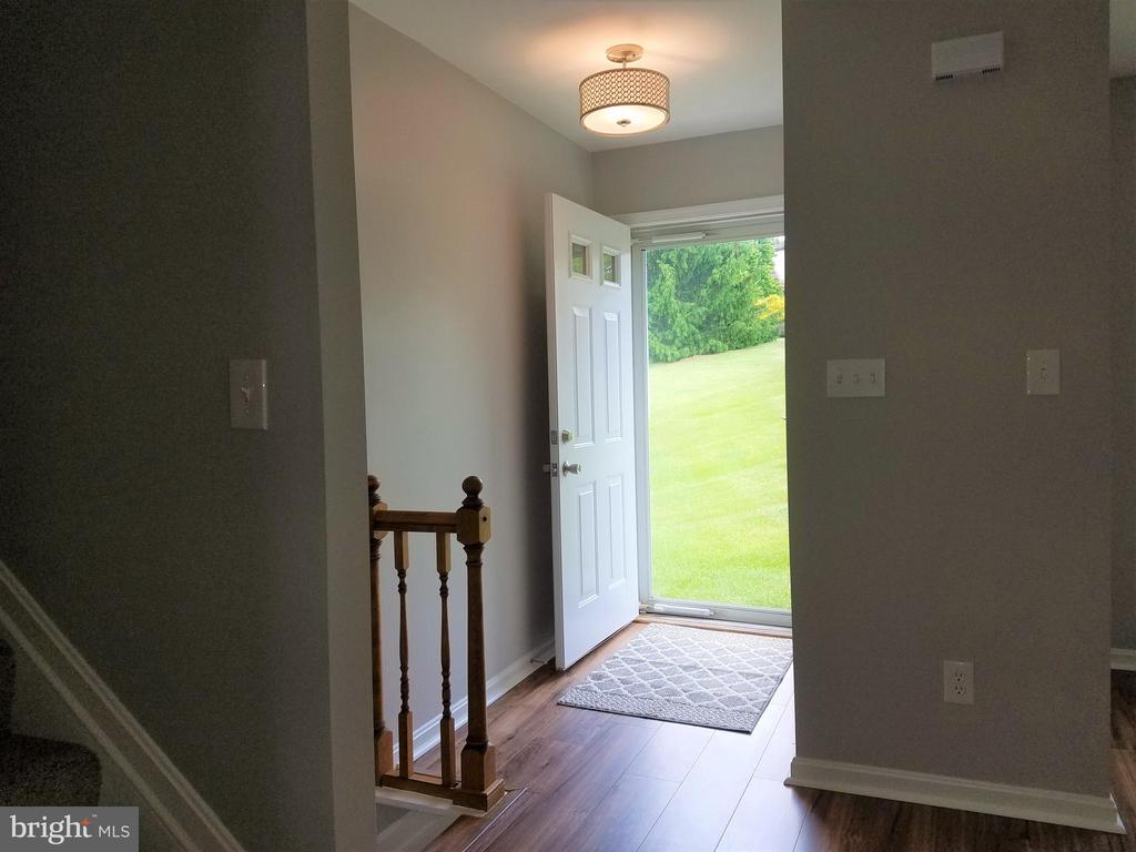 Entrance foyer with closet- storm door - 3290 POMMEL CT, MOUNT AIRY