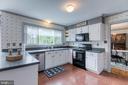 Kitchen with white cabinets & large windows. - 14 STEEPLECHASE RD, FREDERICKSBURG
