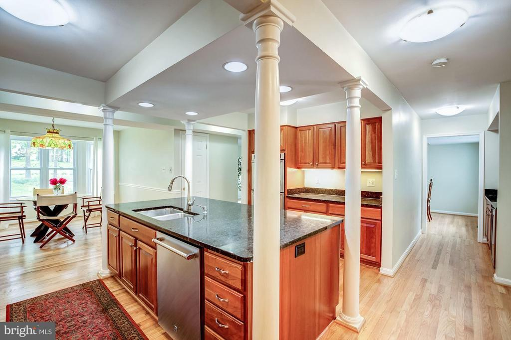Kitchen with gleaming hardwoods & eating area - 11012 BURYWOOD LN, RESTON