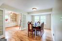 Formal dining room with gleaming hardwood floors - 11012 BURYWOOD LN, RESTON