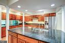 Large kitchen with island - 11012 BURYWOOD LN, RESTON