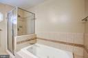 Master bath with separate soaking tub - 11012 BURYWOOD LN, RESTON