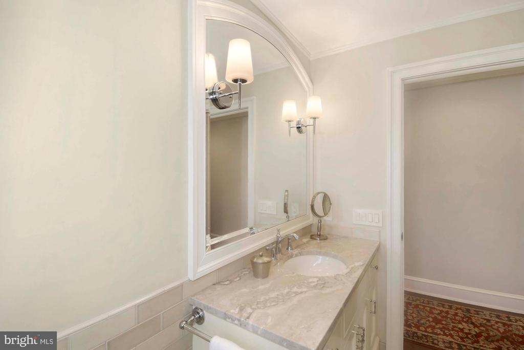Arched mirror w/timeless sconces over the vanity - 223 N ROYAL ST, ALEXANDRIA
