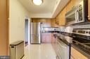 Updated kitchen with stainless steel appliances. - 2230 GEORGE C MARSHALL DR #827, FALLS CHURCH