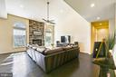 Stacked stone fireplace anchors the room - 3428 COHASSET AVE, ANNAPOLIS