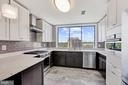 Quartz counters, wood cabinets, SS, porcelain flr - 10201 GROSVENOR PL #1701, NORTH BETHESDA