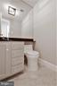 Porcelain floors enhance the powder rm renovation - 10201 GROSVENOR PL #1701, NORTH BETHESDA