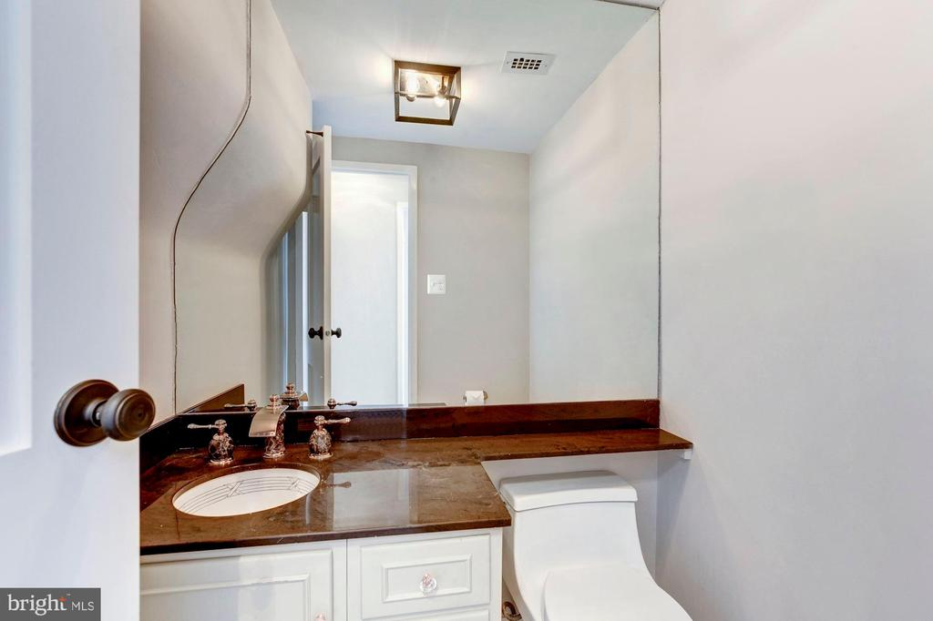 Powder room w/marble counter & Sherle Wagner sink - 10201 GROSVENOR PL #1701, NORTH BETHESDA