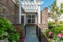 Flagstone walkway and patio at front entrance - 20441 ISLAND WEST SQ, ASHBURN