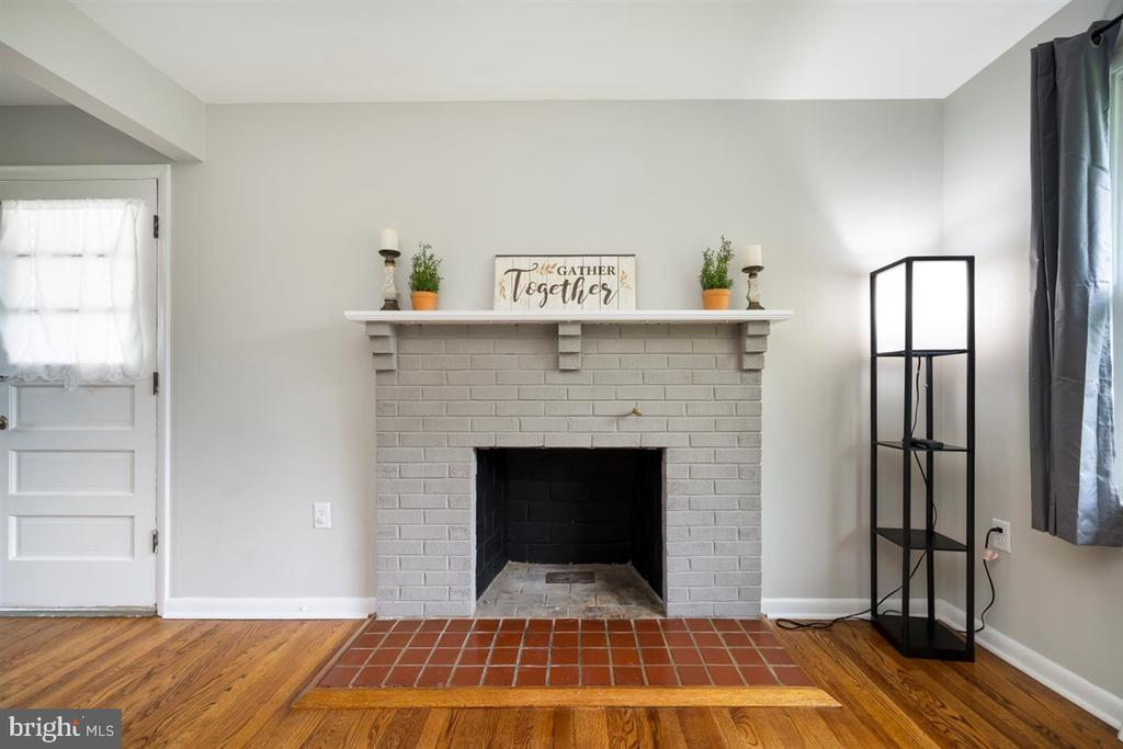 Fireplace with mantle feels like home. - 5239 REELS MILL RD, FREDERICK