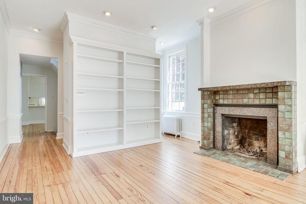 Living room features built-in shelving. - 116 S PITT ST, ALEXANDRIA
