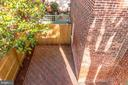 View of rear patio from 2nd level sunroom. - 116 S PITT ST, ALEXANDRIA
