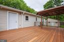 Step outside onto the large back deck from kitchen - 10905 DEERFIELD DR, FREDERICKSBURG