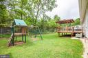 Play set conveniently located near the back deck - 10905 DEERFIELD DR, FREDERICKSBURG
