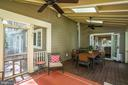 The spacious screened-in porch leads to the deck - 5000 27TH ST N, ARLINGTON