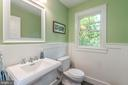 Powder Room with pedestal sink and wainscoting - 5000 27TH ST N, ARLINGTON