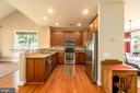 Kitchen features stainless steel appliances - 20441 ISLAND WEST SQ, ASHBURN