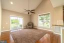 Sunny family room with access to rear patio - 20441 ISLAND WEST SQ, ASHBURN