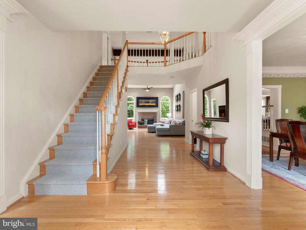 Two story foyer, one of two staircases - 1518 THURBER ST, HERNDON