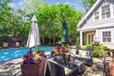 Seating area for entertaining by the pool - 1002 MOSS HAVEN CT, ANNAPOLIS