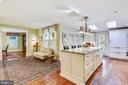 Open view of kitchen into dining room - 1002 MOSS HAVEN CT, ANNAPOLIS