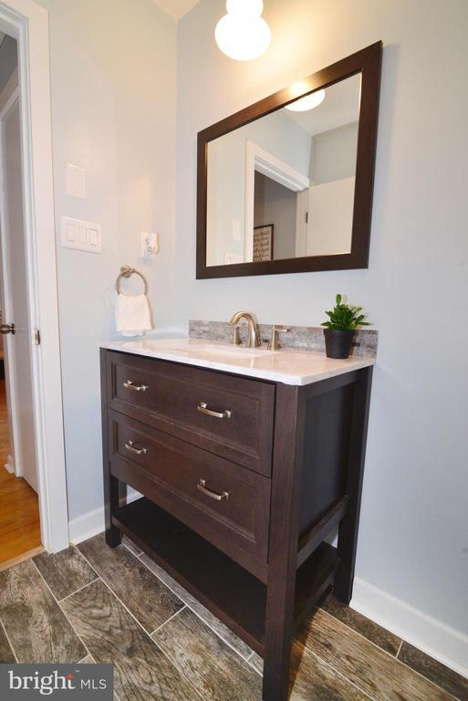 Bathroom #2 with new flooring, vanity and fixtures - 234 PINE CREST LN, BLUEMONT