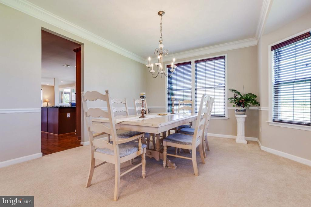 Formal Dining Room with Chair & Crown Moldings - 21921 SILVERDALE DR, ASHBURN