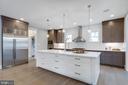 Custom made cabinets / Porcelanosa backsplash - 1313 N HERNDON ST, ARLINGTON