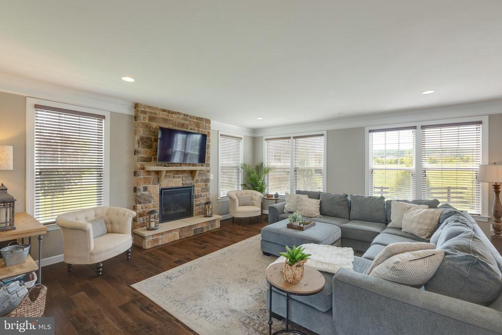 Family room with Stone Fireplace - 15645 CRISTABEL LN, LEESBURG