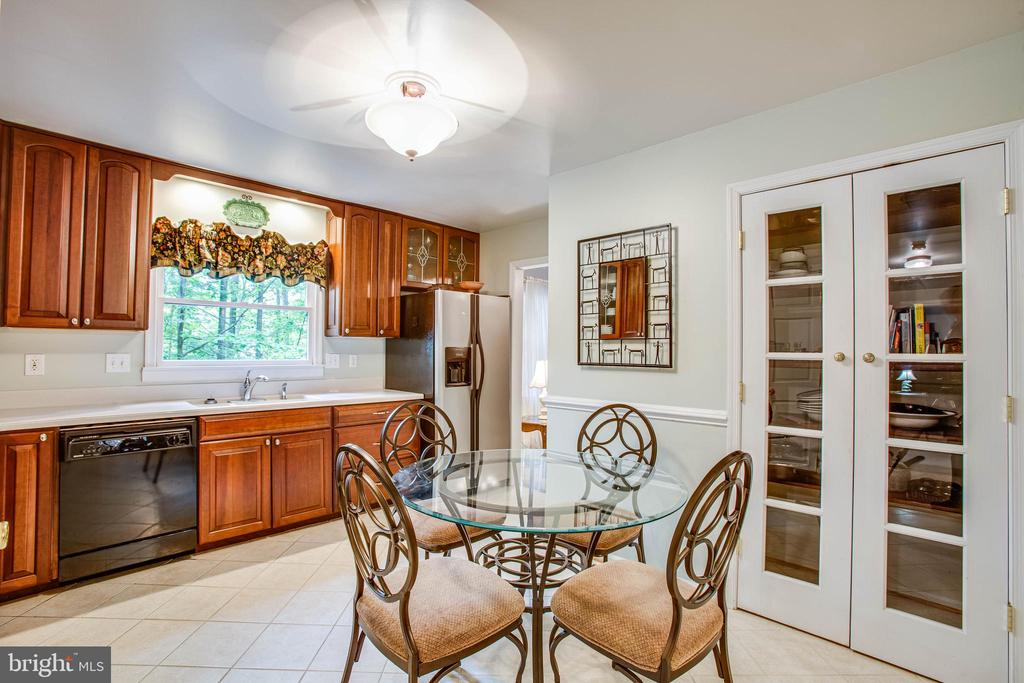 Eat-In Kitchen with glass pantry doors - 22 PAWNEE DR, FREDERICKSBURG