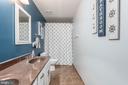 Upstairs hall bath. Linen closet & double sink - 259 HEFLIN RD, STAFFORD