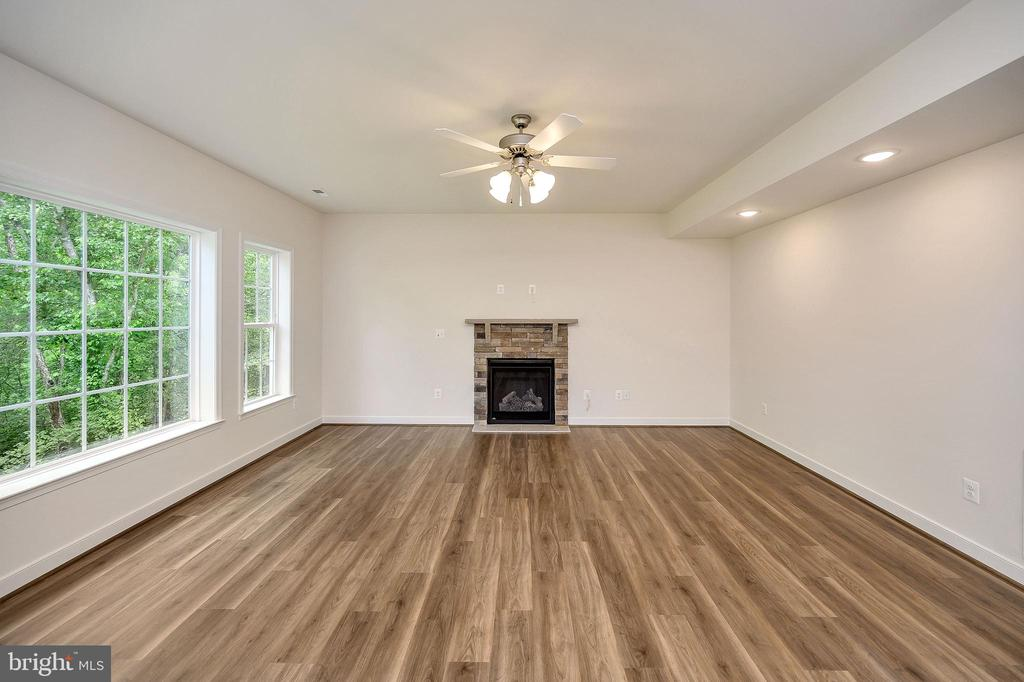 Light filled family room with gas fireplace - 34129 ENCHANTED WAY, LOCUST GROVE