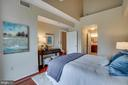 Main level  bedrm w/ high ceiling, balcony access - 1645 INTERNATIONAL DR #407, MCLEAN