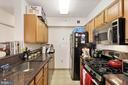 Modern Kitchen with Granite and Stainless Steel - 7111 WOODMONT #701, BETHESDA