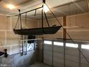 Garage Storage - Canoe does not convey - 112 FREESIA LN, STAFFORD