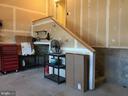 Mower storage under stairs - 112 FREESIA LN, STAFFORD