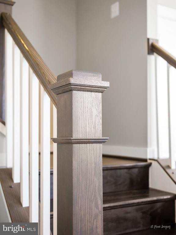 Craftsman style railings accent stunning HW floors - 3239 STONE BARN DR, FREDERICK