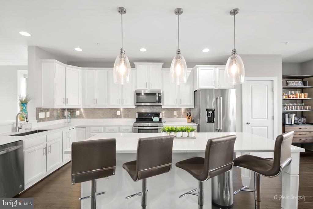 Gourmet kitchen featuring custom pendant lights - 3239 STONE BARN DR, FREDERICK