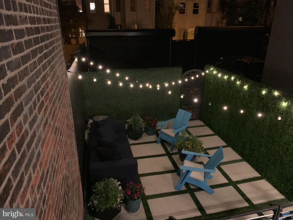 Night shot of the patio - 1313 R ST NW #1, WASHINGTON
