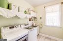 Cheerful Laundry Room just off garage near kitchen - 37986 KITE LN, LOVETTSVILLE