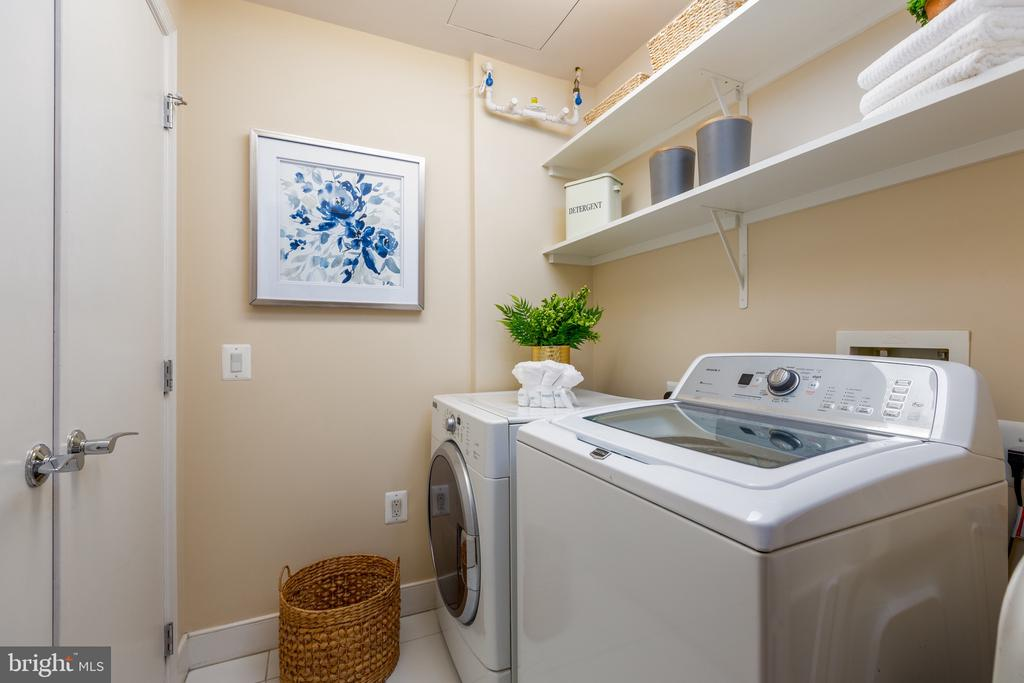Laundry room with closet, hanging and storage - 7710 WOODMONT AVE #802, BETHESDA