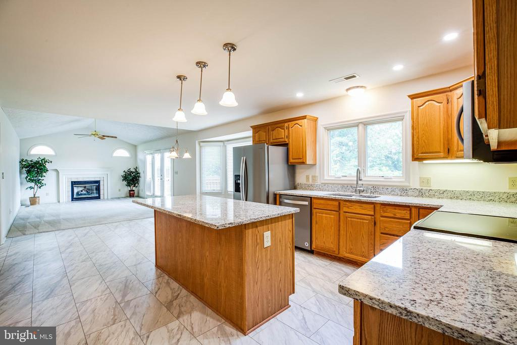 New flooring in the kitchen and dining room. - 208 OLD LANDING CT, FREDERICKSBURG